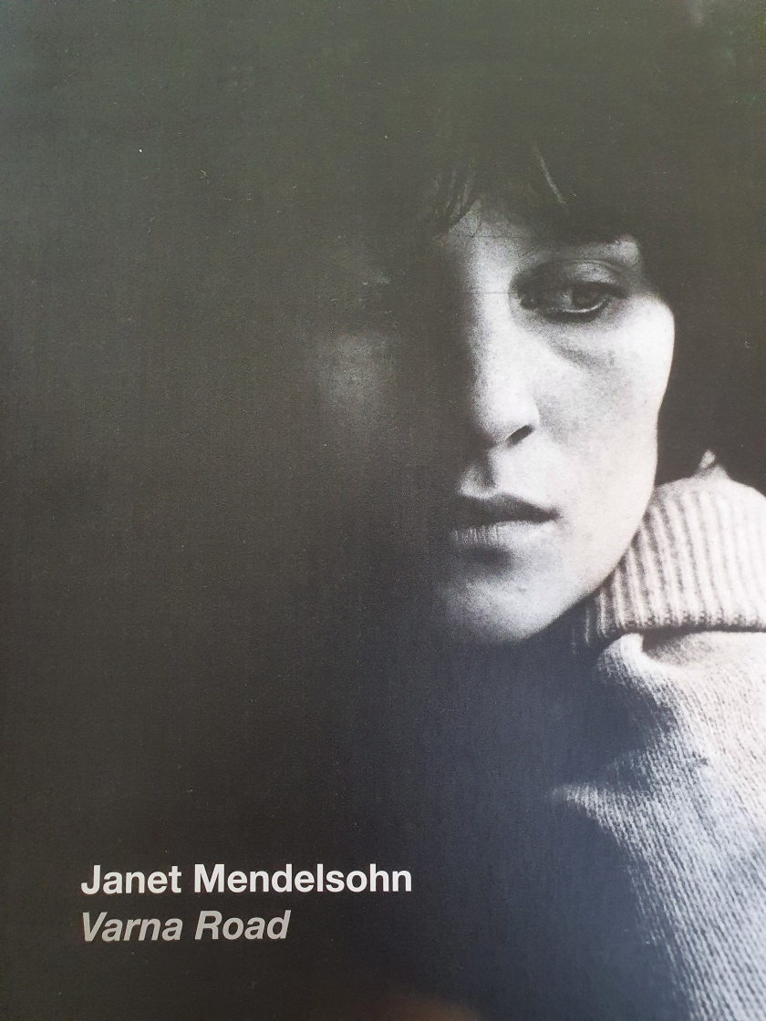 "Image of the cover of the ""Janet Mandelsohn: Varna Road"" exhibition catelogue (2016) image shows black and white close up portrait of ""Kathleen"" in shadow"